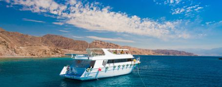 White scuba diving boat on the Red Sea in Egypt with mountain backdrop