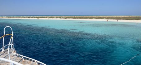 White yacht moored at Hamata island dive site in Egypt.