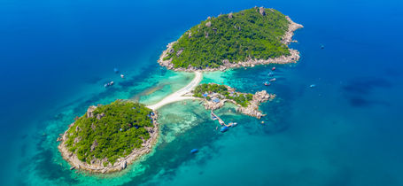 Aerial drone view of tropical Koh Nang Yuan Island surrounded by Turquoise water and white sand bays, near Koh Tao in Thailand