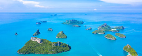Aerial view of Ang Thong National Marine Park islands and boats in Surat Thani, Thailand.