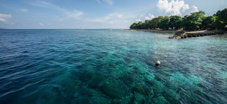 Jetty out over a coral reef on Bunaken Island in Indonesia.