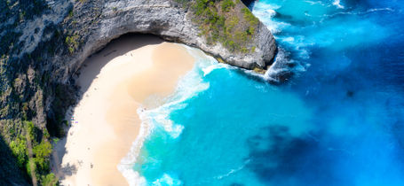 Aerial view of Nusa Penida (T-Rex  Head Beach), with golden sand and tropical water in Bali Indonesia.