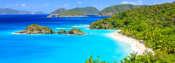 Panorama view of tropical Caribbean islands, green trees, white sand shores and turquoise waters.