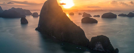 Sunrise over Phang Nga Bay with limestone outcrops and beautiful colours.