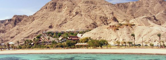 Panorama view of red sea mountain landscape from turquoise green waters.