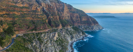 Panorama view of green rocky cape point in South Africa.