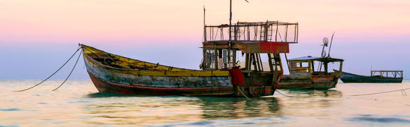 Fishing boats  at sunset in Westmoreland, Jamaica